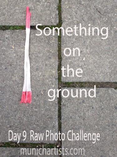 day-9-raw-photo-challenge-something-on-the-ground-stone-tape-375x500