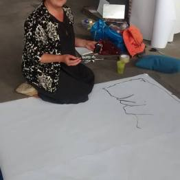Ursula Singer working on the installation