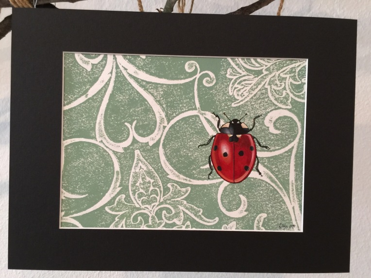One of Nina Schmid's nocturnal art pieces. Ladybug is watercolour the background is a print created using wallpaper and acrylic.