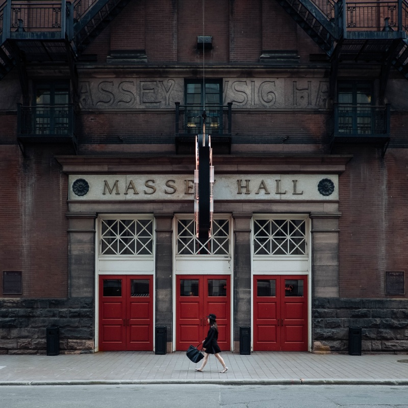 Day 10-masse-hall-three-doors-woman-walking