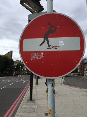 man on street sign in London