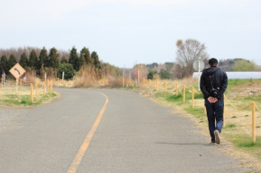 unsplash-kazuend-man-walking-on-road